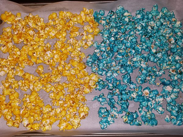 Rainbow Popcorn - Place 2 colors on parchment covered baking sheet